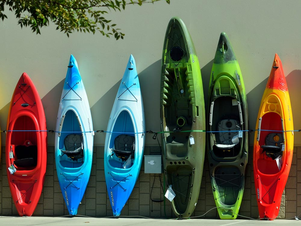 A range of modern kayaks, both sit inside and sit on top.