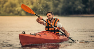 How fast can you paddle a kayak. Photo of a man paddling