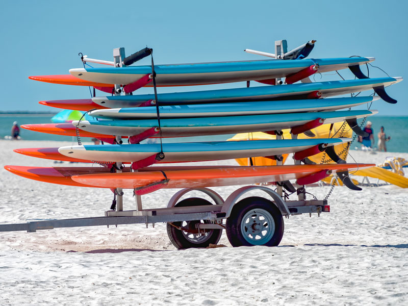 are inflatable boards any good? They are much easier to store. picture of paddle boards on a trailer on the beach